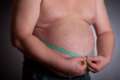 Fat Man Holding A Measurement Tape Royalty Free Stock Photo