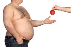 Fat man holding apple Stock Photography