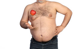 Fat man holding apple Stock Images