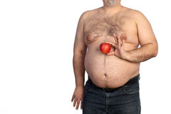Fat man holding apple Stock Photo