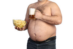 Fat man holding beer, chips and tv remote stock images