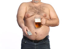 Fat man holding beer, chips and tv remote Royalty Free Stock Photo