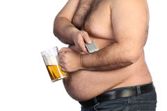 Fat man holding beer, chips and tv remote Royalty Free Stock Image