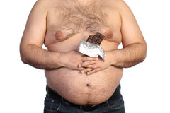 Fat man holding chocolate Stock Photography
