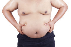 Fat man holding his stomach Stock Image