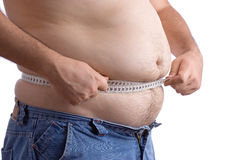 Fat man holding a measurement tape Royalty Free Stock Photos