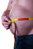 Fat man holding a measurement tape stock image