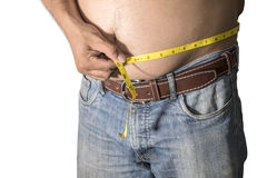 Fat man holding a measuring tape Stock Image