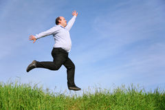 Fat Man Jumps On Meadow Stock Photos