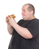 Fat Man Looks Lustfully at a Burger Stock Photography