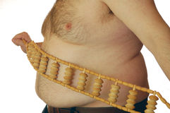 Fat man with a massager Stock Images