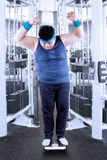 Fat man measure his weight 1. Full length of fat man measure his body in the fitness center Stock Photo