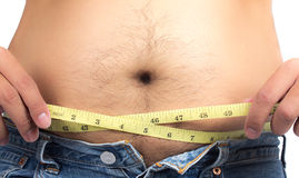 Fat man measure waist circumference stock images