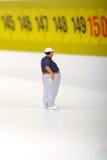 Fat man on a measurer - miniature Stock Image