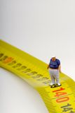 Fat man on a measurer - miniature Royalty Free Stock Image