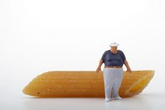 Fat man miniature and pasta Stock Images