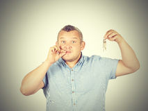 Fat Man with mouth shut holding a keys Stock Photography