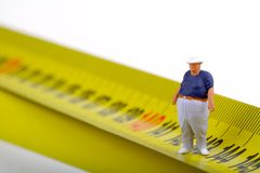 Free Fat Man On A Measurer - Miniature Stock Images - 52346044