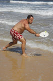Fat man playing beach tennis on the beach Royalty Free Stock Images