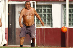 Fat man playing football Stock Images