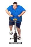 Fat man playing sport Royalty Free Stock Image