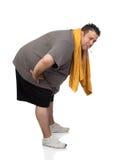 Fat man playing sport and smoking Royalty Free Stock Photos