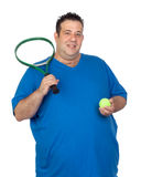 Fat man with a racket for play tennis Royalty Free Stock Photo