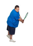 Fat man with a racket playing tennis Stock Photography