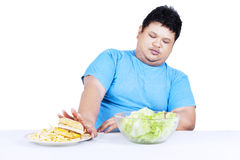Fat man refuse junk food 1 Stock Photography