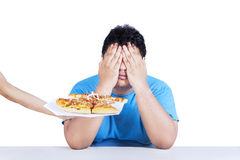 Fat man rejecting junk food 3 Stock Photo