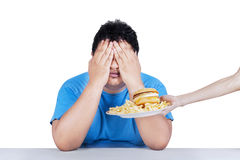 Fat man rejecting junk food 1. Fat man rejecting to eat junk food. Isolated on white background Royalty Free Stock Photos