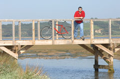 Fat man resting over bridge looking to landscape Stock Images