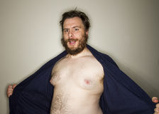Fat man revealing himself Royalty Free Stock Photos