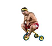 Fat man riding a small bicycle Royalty Free Stock Images
