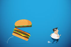 Fat man running away from burger, diet and health concept Stock Photos