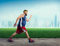 Fat man running Royalty Free Stock Photo