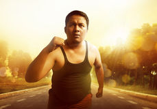 Fat man running. At sunset Stock Photo