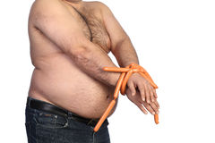 Fat man and sausages Royalty Free Stock Photography