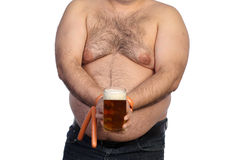 Fat man and sausages Royalty Free Stock Photo
