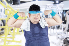 Fat man showing his arm bicep 1 Royalty Free Stock Images