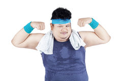 Fat man showing his arm bicep 2 Royalty Free Stock Images