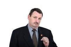 Fat man shows communist pin Stock Image