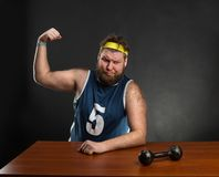 Fat man shows his muscle Stock Images