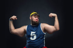 Fat man shows his muscle Stock Image