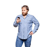 Fat man with smartphone on a white background Royalty Free Stock Image
