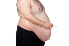 Fat man smoking Royalty Free Stock Photos