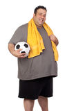 Fat man with a soccer ball Stock Photography