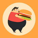 Fat man in state of hypnosis eat burger Royalty Free Stock Photo