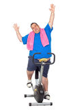 Fat Man in a Static Bicycle Royalty Free Stock Photography