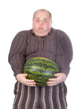Fat man struggling to hold the watermelon Stock Image